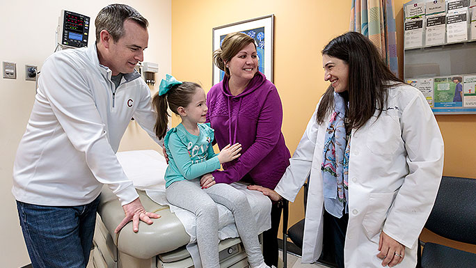 Pediatric rheumatologist Dr. Melissa Tesher consulting with a young patient and her family